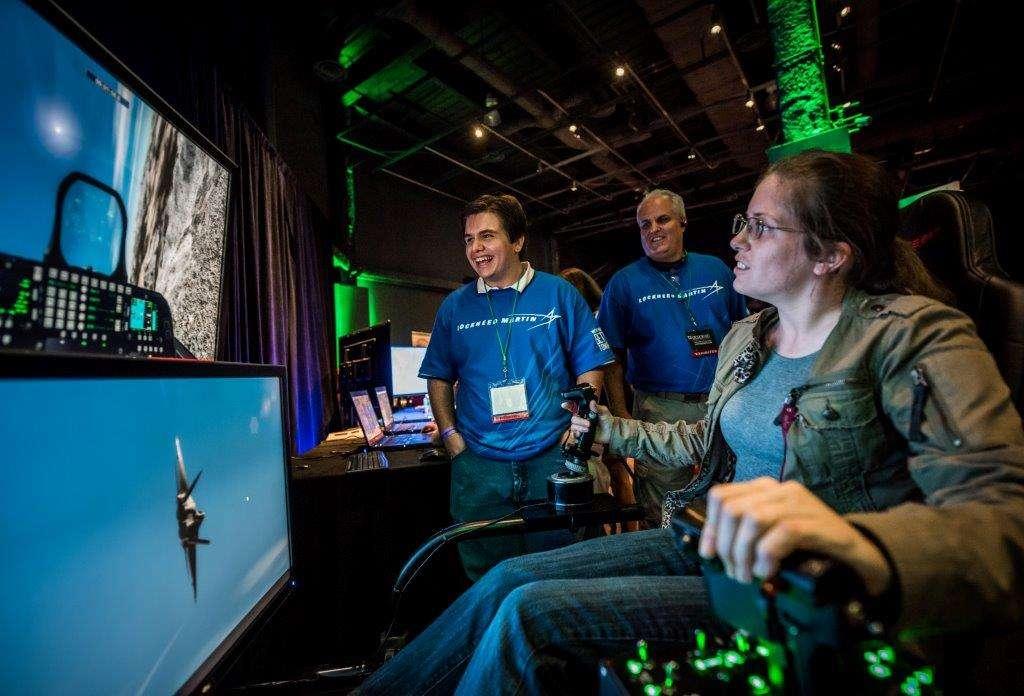 Orlando Science Center visitors check out Lockheed Martin's military flight simulator at last year's Otronicon. Photo: Orlando Science Center