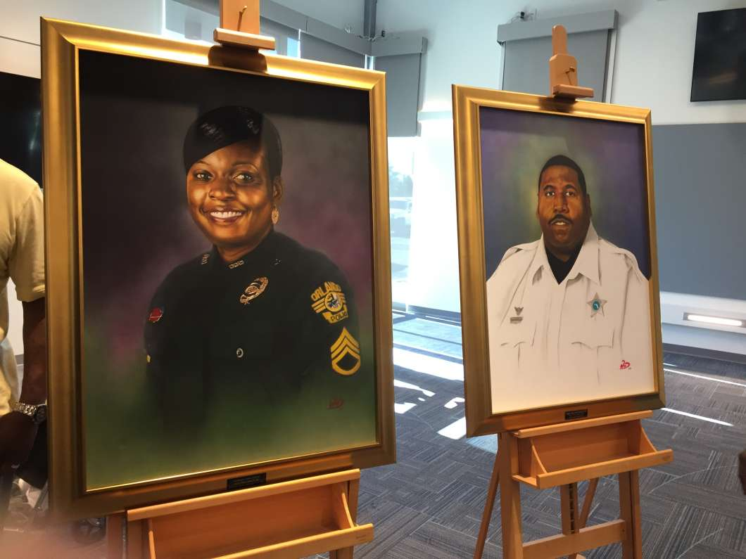 Lt. Debra Clayton and Deputy Norman Lewis were memorialized with portraits that will be hung at police headquarters.