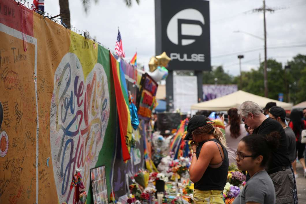 One year after the Pulse shooting, the community gathers at the club for vigils and remembrance. Photo: Joey Roulette