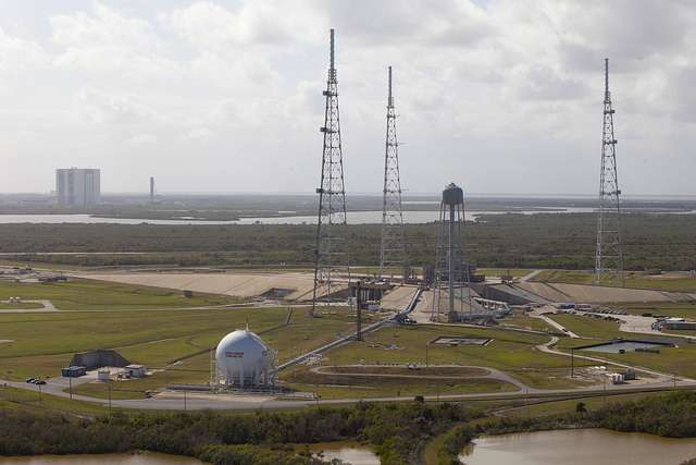 An aerial view of Launch Pad 39B at NASA's Kennedy Space Center in Florida. In view in the background is the Vehicle Assembly Building and the mobile launcher. Photo: NASA/Bill White