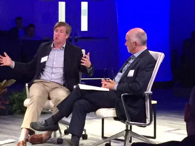 Patrick Kennedy, left, talks to a panel of health care industry workers in Orlando about his experience with addiction.