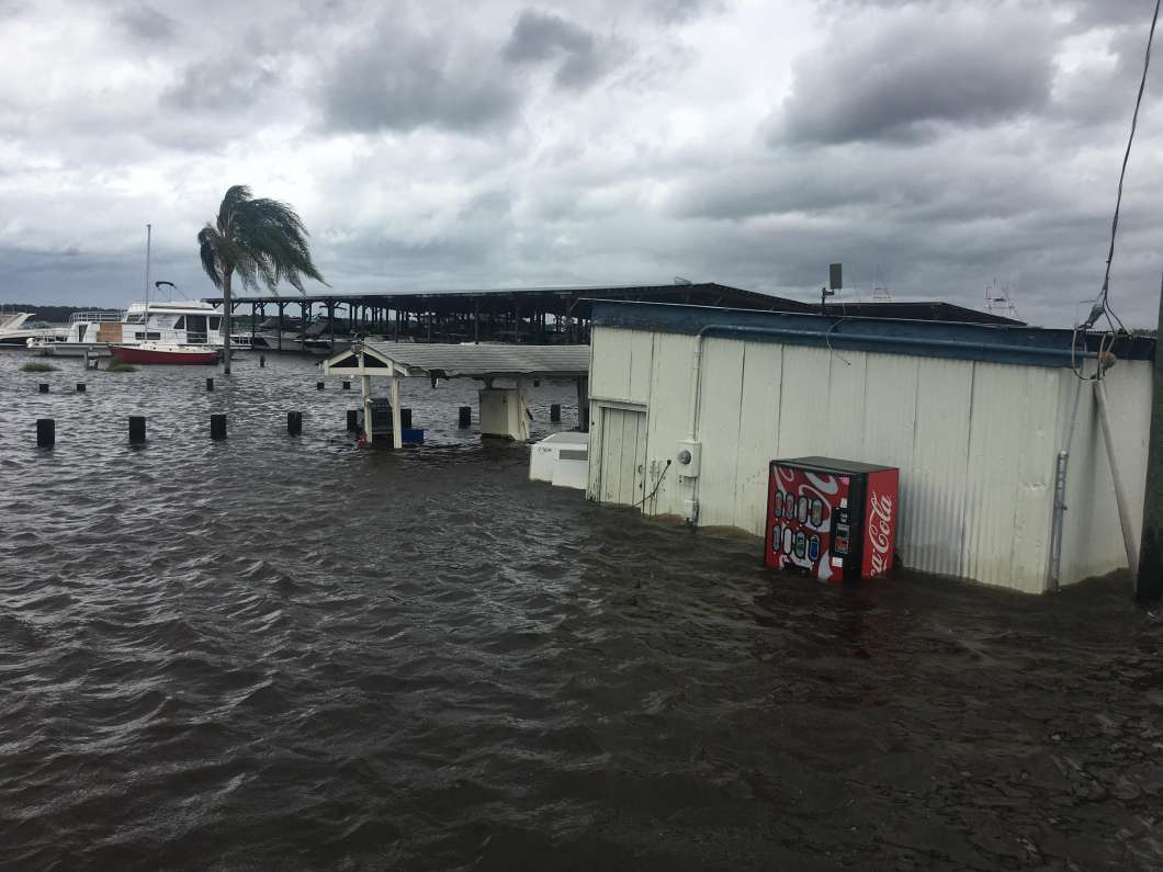 The parking lot is flooded at Doctors Lake Marina in Orange Park. Photo: Lindsay Kilbride, WJCT