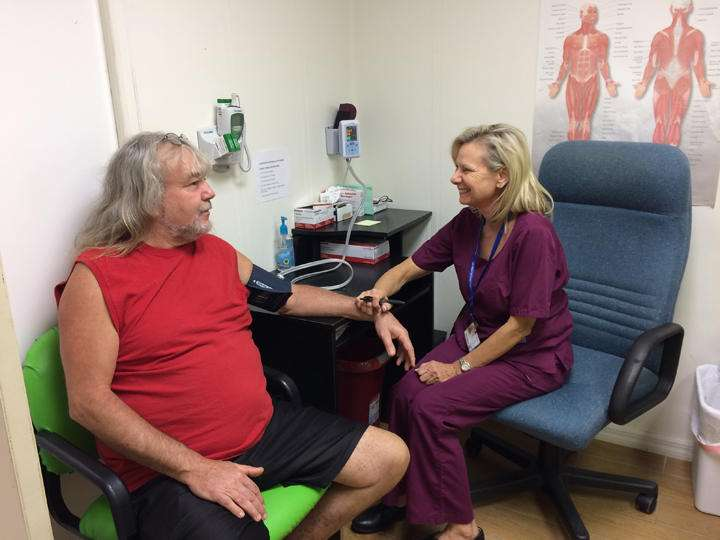 Kim Harden takes a patient's blood pressure at the Lake Wales Free Clinic. (Julio Ochoa, WUSF)