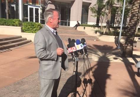 At a press conference outside City Hall, Mayor Buddy Dyer said he will run again in 2019./Photo: Catherine Welch WMFE