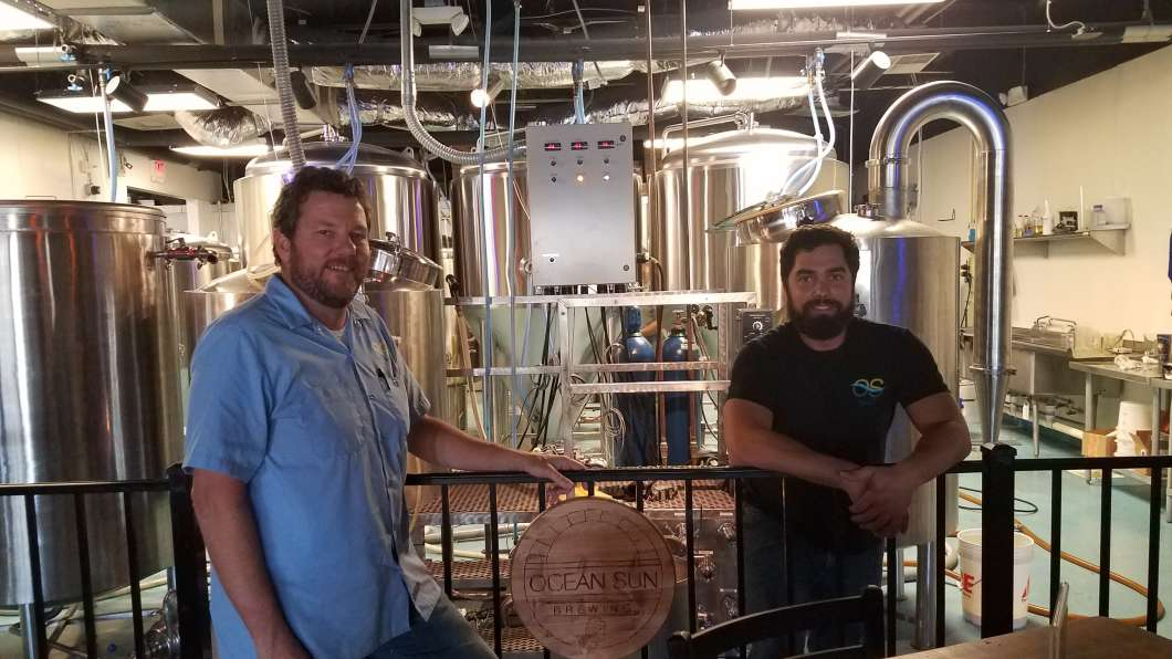 Left to right is Bob DeWeisse and Assistant Brewer, Geovanni Cantizano. Photo: Brendan Byrne WMFE.