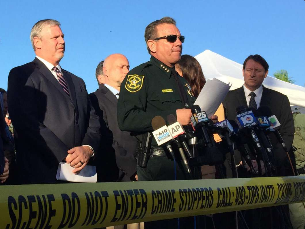 FBI Miami Special Agent in Charge Robert Lasky, left, and Broward Sheriff Scott Israel (center) brief reporters about the Stoneman Douglas High School shooting in Parkland, Fla. on Feb. 15, 2018. (Peter Hayden, WLRN)