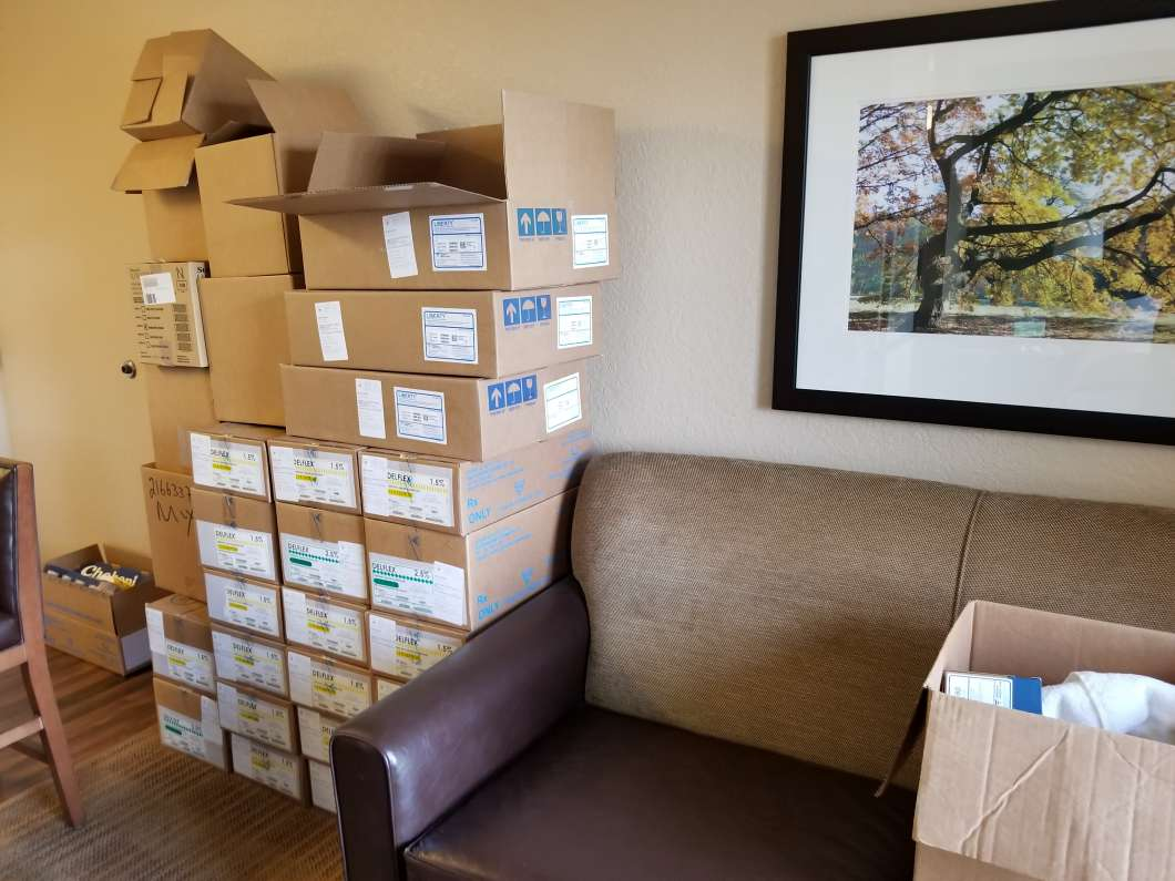 Boxes stack up at Katherine De La Rosa's temporary hotel room. Photo by Crystal Chavez.