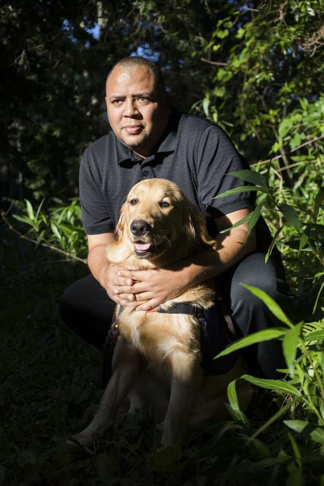 Omar Delgado's therapy dog Jediah helps give him purpose. (Cassi Alexandra, special to ProPublica)