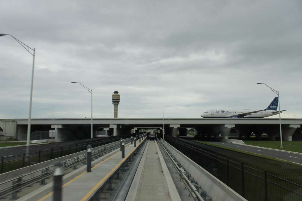 A Jetblue plane taxis over the APM track to the South Terminal. Photo: Matthew Peddie, WMFE