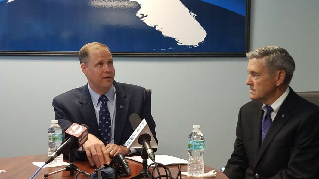 NASA Administrator Jim Bridenstine (L) and Kennedy Space Center Director Bob Cabana (R) meet with reporters at Space Florida's Space Life Sciences Lab. Photo: Brendan Byrne / WMFE