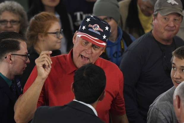 Photo by Andy Cross, The Denver Post. Donald Trump supporter gets heated toward a member of the media.