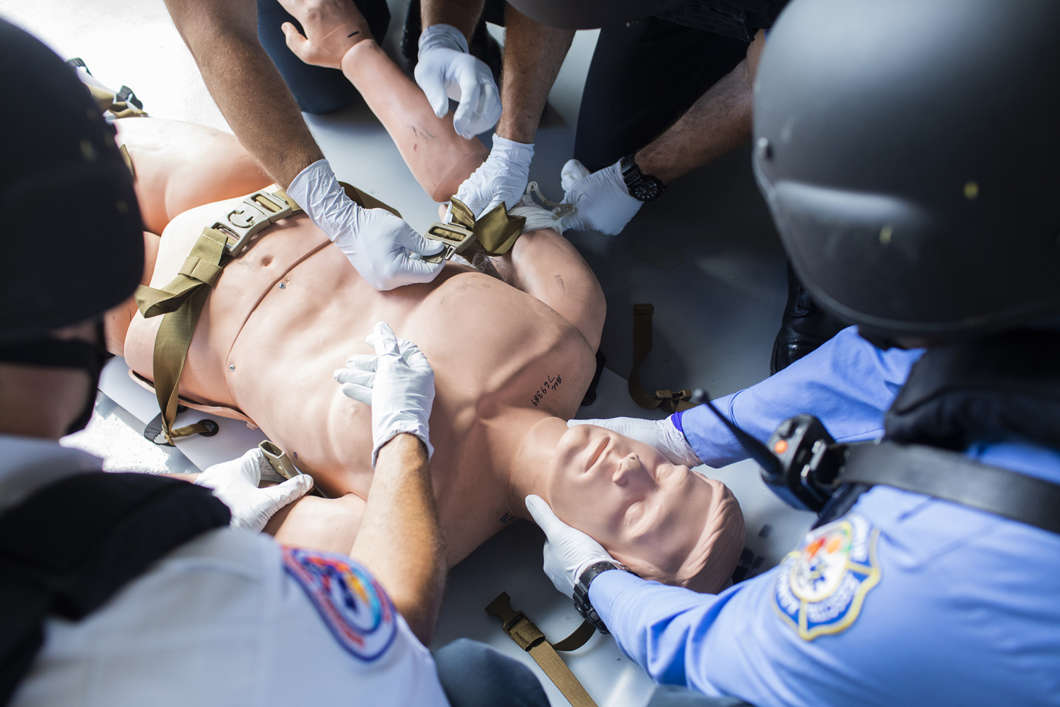 Orange County Swift Assisted Victim Extraction (S.A.V.E) Team performs an extraction on a dummy at Fire Station 67 on September 12, 2018 in Orlando, Florida. The Orlando Fire Department had received special equipment and training to respond to an active shooter situation, but when Pulse happened, none of it was used. (Cassi Alexandra for ProPublica)