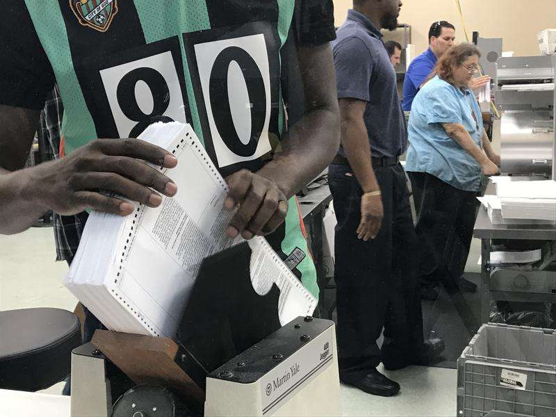 Staff at the Broward Supervisor of Elections Office sort all of the Page Ones from ballots. Photo: Caitie Switalski, WLRN