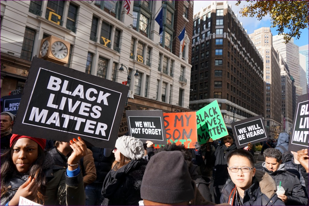 NYC action in solidarity with Ferguson. Mo, encouraging a boycott of Black Friday Consumerism. Photo taken by The All-Nite Images