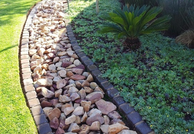 French drains 101 bob vila for Yard drainage slope