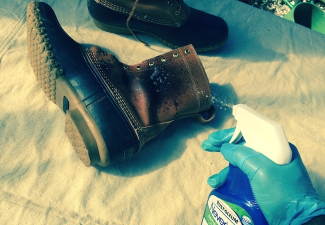 spraying NeverWet on leather workboots