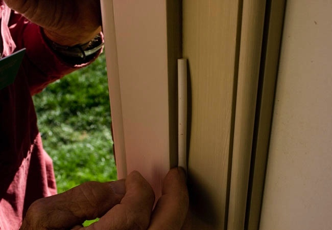 Door weather stripping the right way bob vila for Door weather stripping