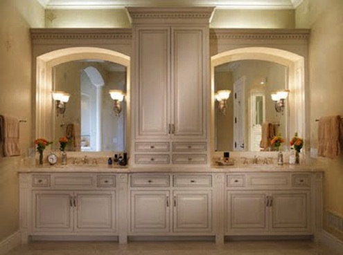 Small bathroom storage ideas bob vila for Master bathroom cabinet designs
