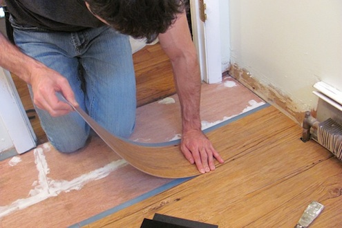 Installing vinyl plank flooring. Photo: JProvey