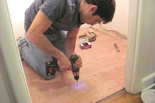 Installing Vinyl Plank Flooring - Screwing In Underlayment