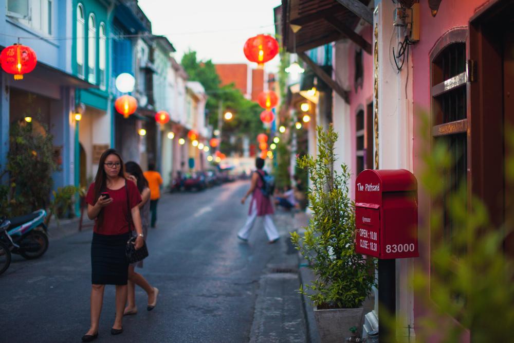 Visitors walk Chinatown in Phuket_343653989