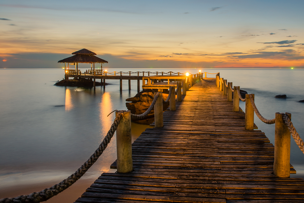Landscape of Wooded bridge pier between sunset_242658232