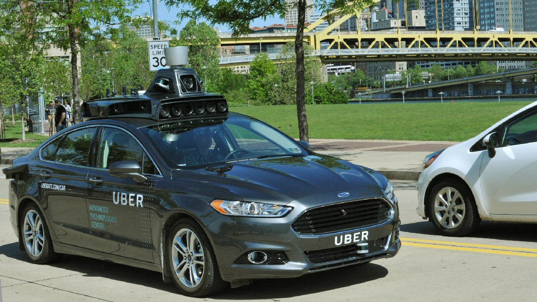 In this undated photo provided by Uber, a Ford Fusion hybrid outfitted with radars, laser scanners and high-resolution cameras drives along the streets of Pittsburgh. Ride-hailing company Uber Technologies Inc. is testing the self-driving car on public streets in the city. San Francisco-based Uber says Pittsburgh is an ideal place to test self-driving cars because it has a wide variety of weather and road types. (Uber via AP) MANDATORY CREDIT