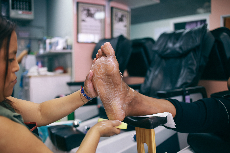 Images of Black Man receiving pedicure