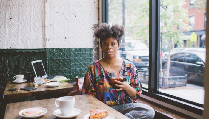 Coffeetographer sits in BREWKLYN enjoying a cold brew