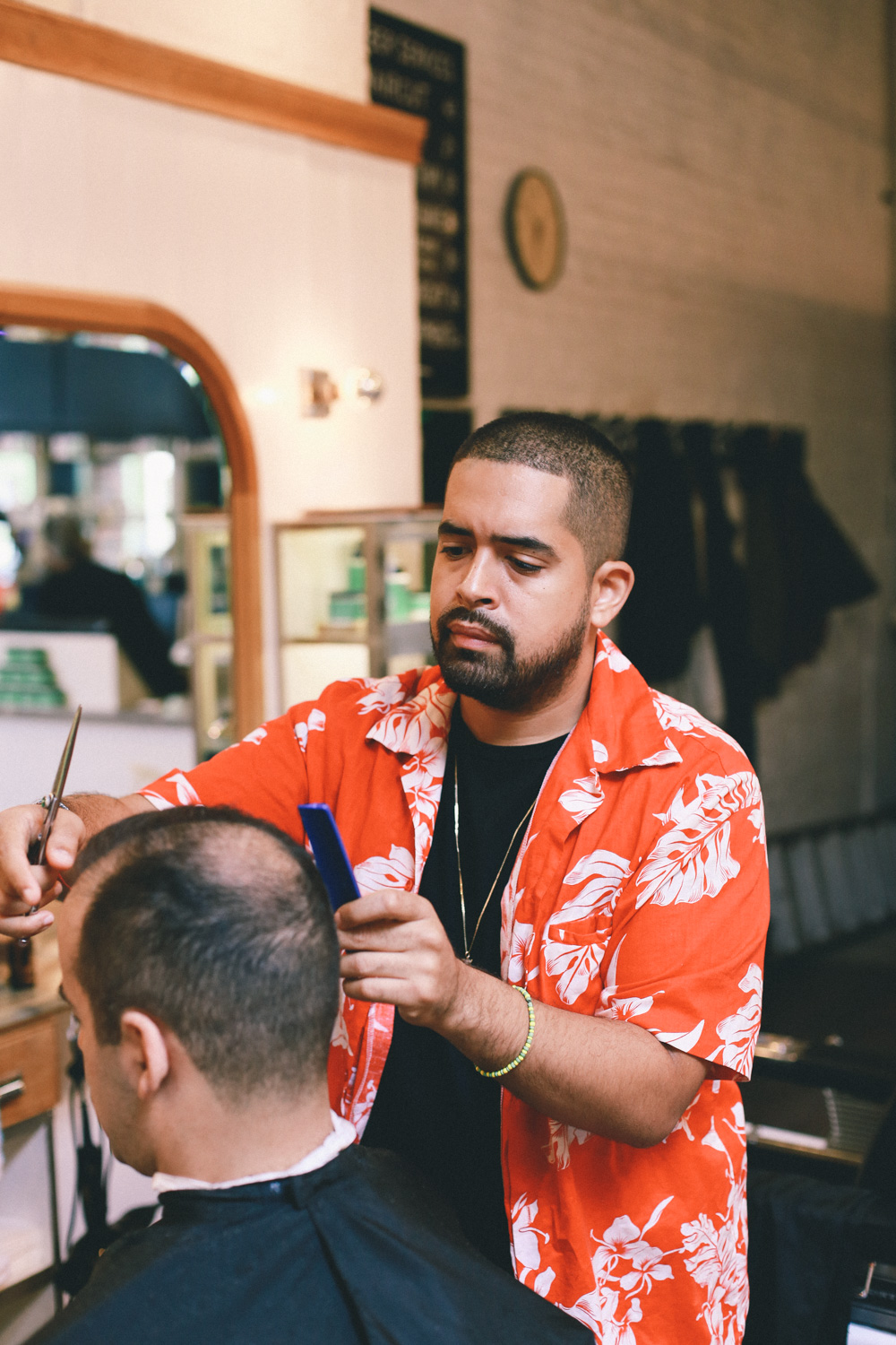 Jay Smooth gets his hair cut at Fellow Barber
