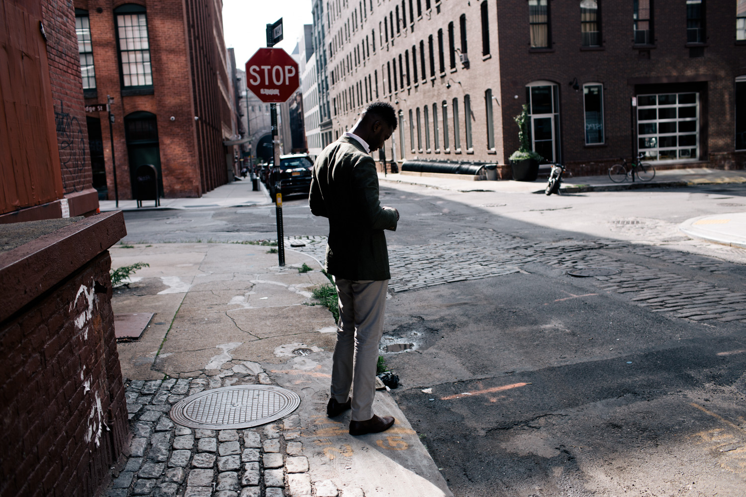 Wayne Wilson in a green jacket in the streets of Dumbo