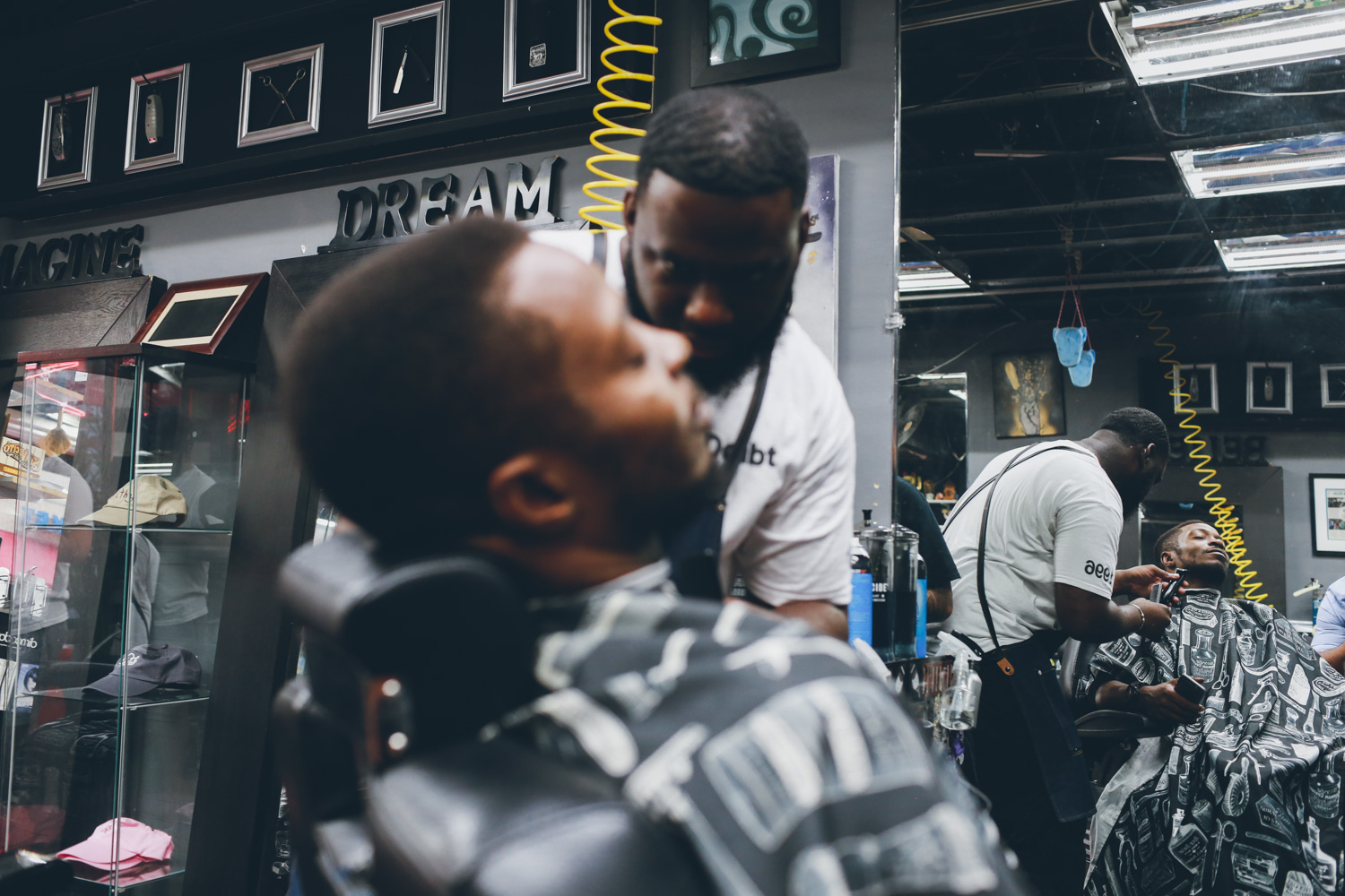 Jungle getting a cut in Filthy Rich Barbershop