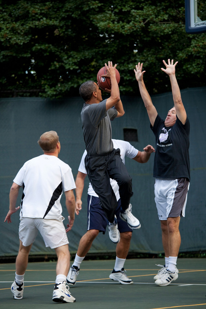 President Barack Obama takes a shot during a game with Cabinet Secretaries and Members of Congress on the White House basketball court, Oct. 8, 2009. (Official White House Photo by Pete Souza) This official White House photograph is being made available only for publication by news organizations and/or for personal use printing by the subject(s) of the photograph. The photograph may not be manipulated in any way and may not be used in commercial or political materials, advertisements, emails, products, promotions that in any way suggests approval or endorsement of the President, the First Family, or the White House.