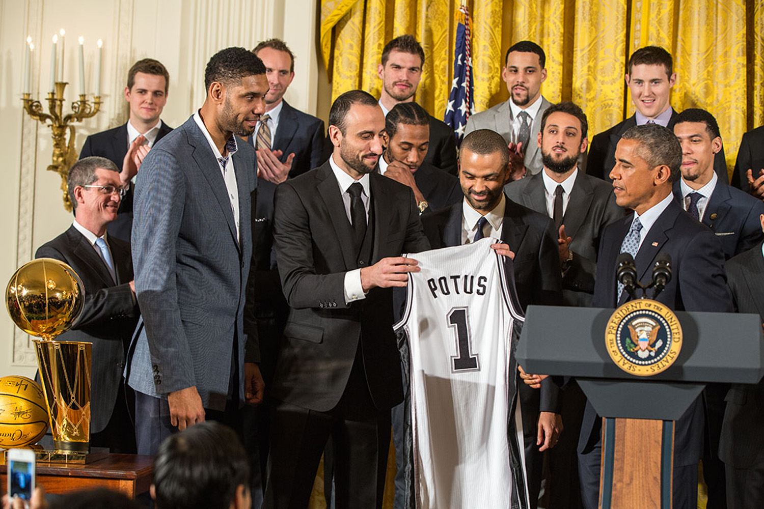 Tim Duncan, Manu Ginóbili and Tony Parker present President Barack Obama with a Spurs team jersey during an event to welcome the 2014 NBA Champion San Antonio Spurs in the East Room of the White House, Jan. 12, 2015. (Official White House Photo by Pete Souza)