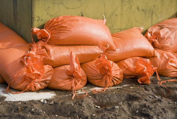 Sandbags piled around a structure to protect it from rising flood waters.