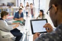 EDDDY0 Businessman using digital tablet in meeting