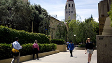 Students walk past Stanford University's Graduate School of