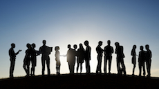 Silhouettes of Business People on a Meeting Outdoors