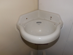 "The ""Novenus"" wall mounted corner basin"