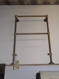 Brass heated towel rail