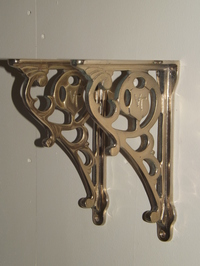 Pair of ornate cistern/shelf brackets