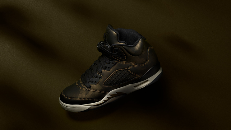 385bbd8efb2c8 The Air Jordan 5, designed by Tinker Hatfield and inspired by the look of  fighter planes, first dropped in 1990. Its premier colorway featured a  metallic ...