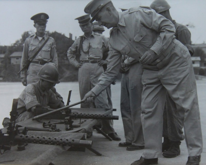 A photo of first KMAG Chief BG Roberts working with Korean soldiers