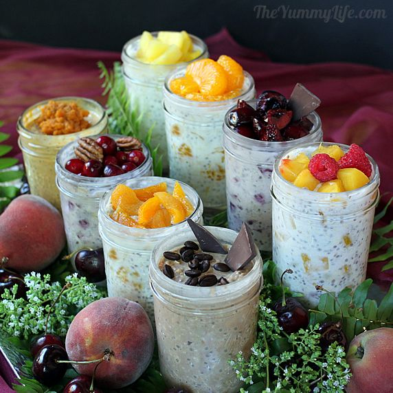 Jars of refrigerator oatmeal brimming with toppings. Looks like some of the combinations are raspberry peach, chocolate coffee bean, cranberry almond, mandarin orange, chocolate strawberry, pineapple.