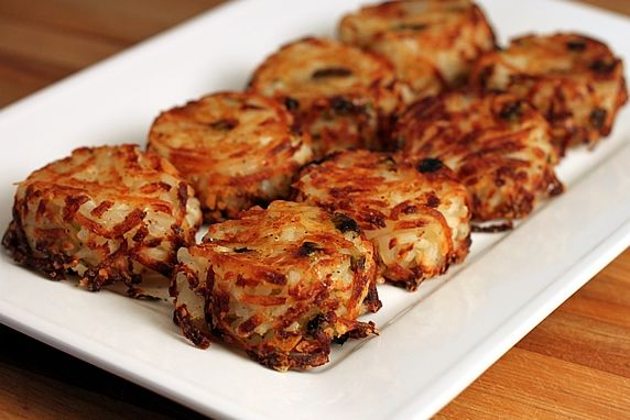 These individual servings of hash browns are convenient to make and serve. The potatoes are tender and moist on the inside and crispy on the outside. The Parmesan cheese adds delicious flavor.