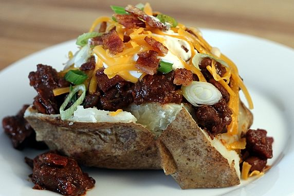 These loaded baked potatoes are hearty, comforting, and delicious. They're fun for a family meal or party buffet. Offer lots of toppings or just a few. The sky's the limit!