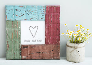 colored frame with heart and quote FOLLOW YOUR HEART  and chamomile in diy concrete pot. Skandinavian style room interior