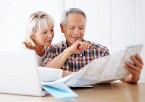 senior couple, looking at finances