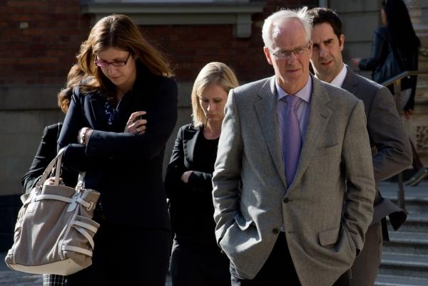 Former Nortel CEO Frank Dunn, right, leaves court in Toronto in September.