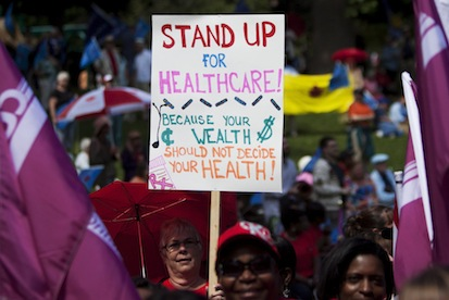 Protesters rally to demonstrate for healthcare reforms near the site when there Premiers are meeting for the Council of the Federation tdoday